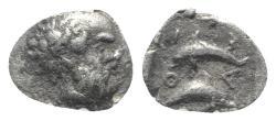 Ancient Coins - Island of Thrace. Thasos, c. 412-404 BC. AR Hemiobol. Head of satyr  R/ Two dolphins