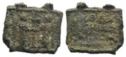 Ancient Coins - Byzantine Lead Plaquette, c. 13th-14th centuries. Two angel standing facing. R/ Inscription in three lines.