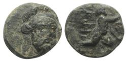 Ancient Coins - Troas, Ophrynion, 4th century BC. Æ 11mm. Helmeted head of Hektor  R/ Infant Dionysos RARE