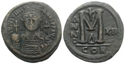 Ancient Coins - JUSTINIAN I. 527-565 AD. Æ Follis. Constantinople mint, 4th officina. Dated RY 12 (538/9 AD).