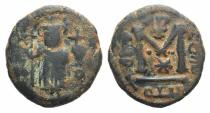World Coins - ISLAMIC, Umayyad Caliphate. temp. Mu'awiya I ibn Abi Sufyan. AH 41-60 / AD 661-680. Æ Fals