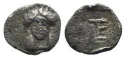 Ancient Coins - Ionia, Kolophon, c. 450-410 BC. AR Tetartemorion. Facing head of Apollo. R/ TE monogram (mark of value)