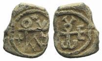 Ancient Coins - Byzantine Pb Seal, c. 7th-12th century (12mm). Cruciform monogram. R/ Monogram; below, ΛO and star