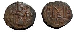 Ancient Coins - ISLAMIC, Umayyad Caliphate. Arab-Byzantine coinage (Standing Emperor type). Circa 680s. Æ Fals